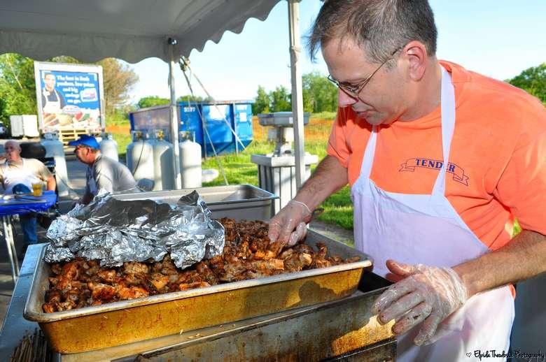 man cooking Greek food