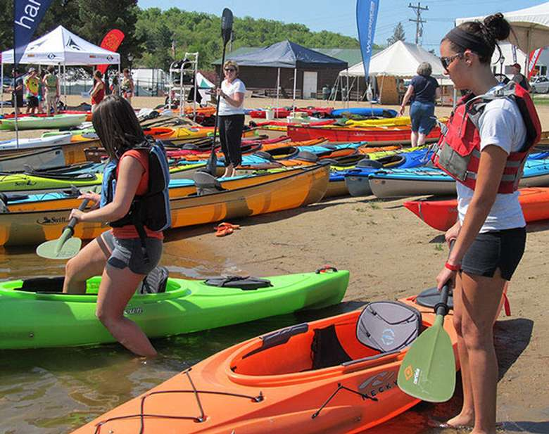 people standing near kayaks for demos