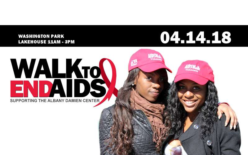 two women in a walk to end AIDS poster