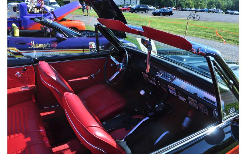 inside of a classic car, red