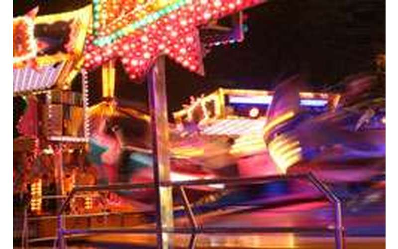 blurry photo of a ride at the fair