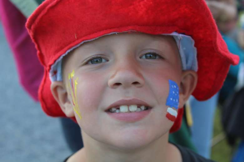 kid with face paint for 4th of July