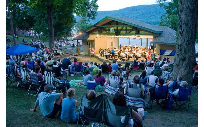 audience in shepard park on the lawn listening to music in lake george