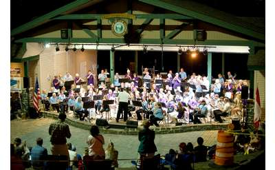 band playing in an amphitheatre at night