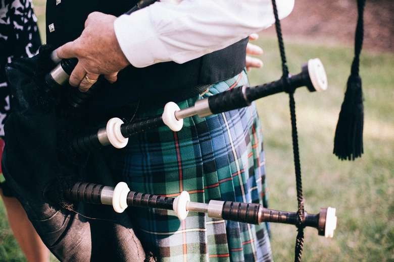 close up of bagpipes on a person