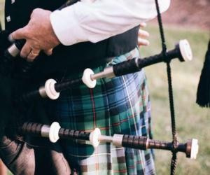 close up of a a guy with a bagpipe