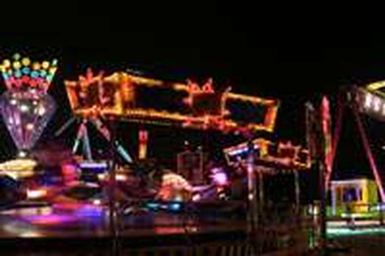 blurry image of lights at night at the fair