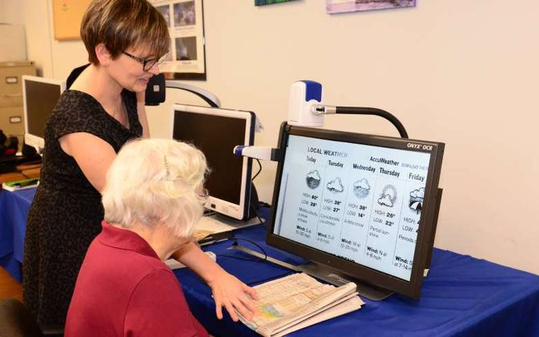 two women looking at an electronic screen