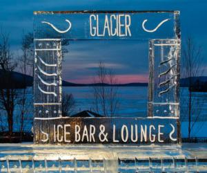 glacier ice bar & lounge sign carved out of ice