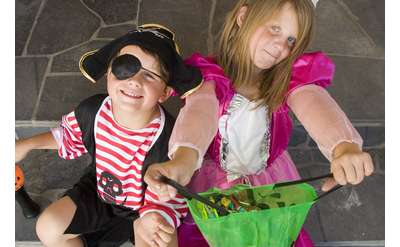 two costumed kids - boy pirate and girl princess