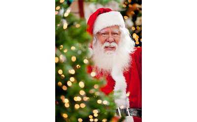photo of Santa near a tree