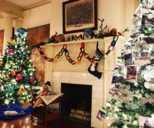 decorated trees near fireplace
