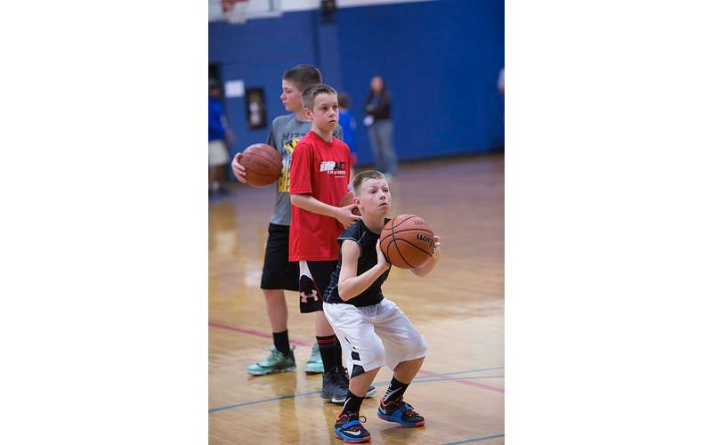 young boy about to shoot a basketball