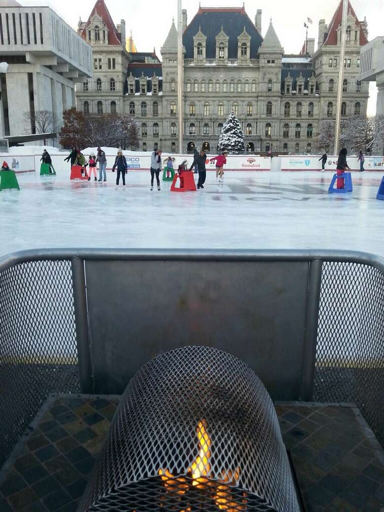 people skating in front of the plaza