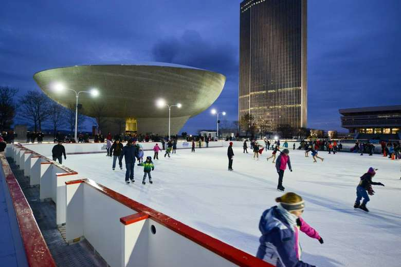 people skating with the egg in the background