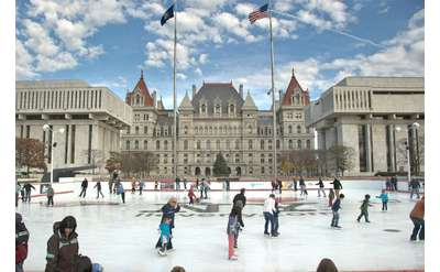 people skating in front of the capitol building