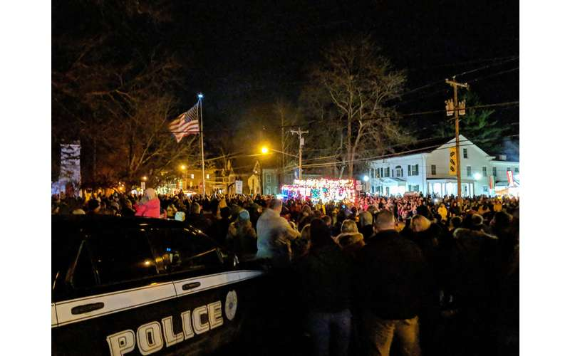 parade crowd and police car