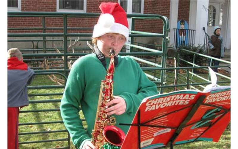 person playing saxophone in holiday costume