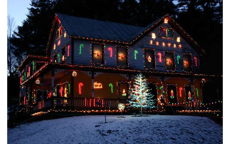 house decorated with holiday lights