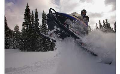 snowmobile jumping in the air