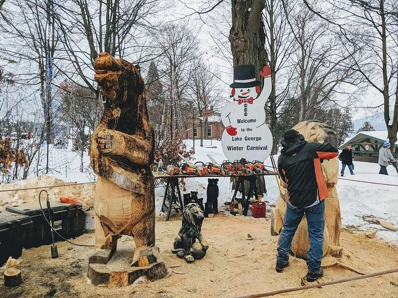 man doing chainsaw carvings