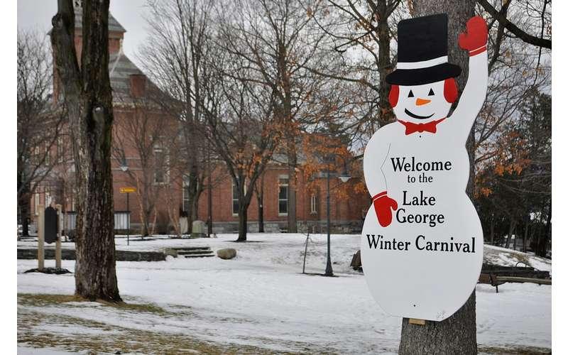 lake george winter carnival snowman sign