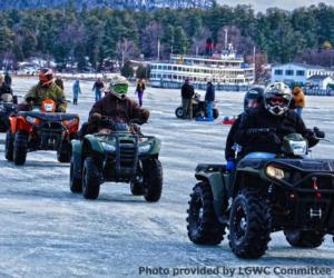 people riding 4-wheelers on ice