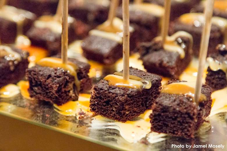what looks like chocolate appetizers with toothpicks