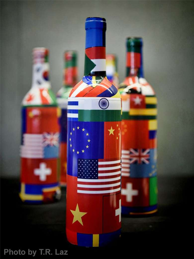wine bottles with international flags on them