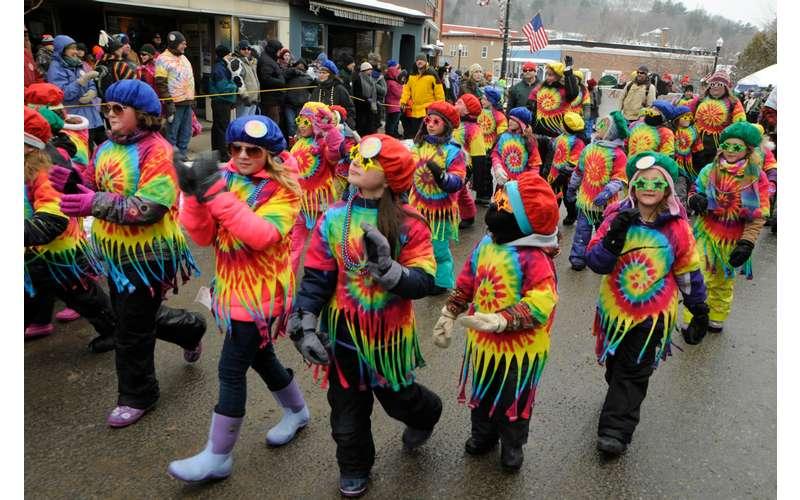 parade group wearing tie dye shirts