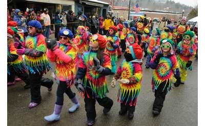 parade group wearing tie dye shirts