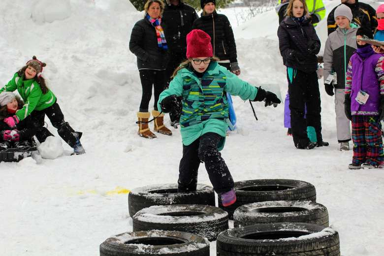 kid in obstacle course in snow