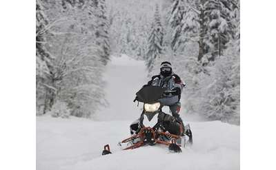 snowmobile rider in the snow