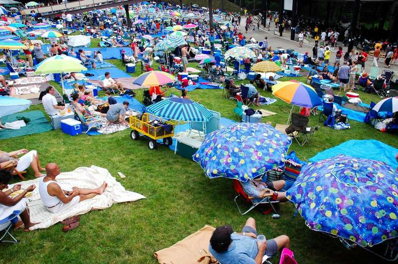 Large crowd sitting on the grass for the jazz festival at SPAC