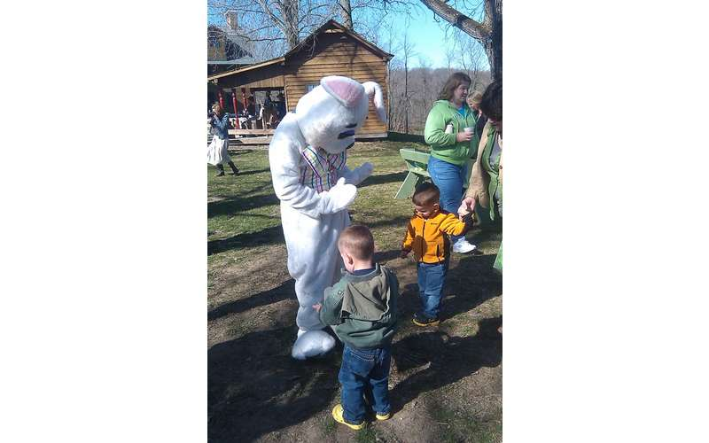 Easter Bunny talking to kids