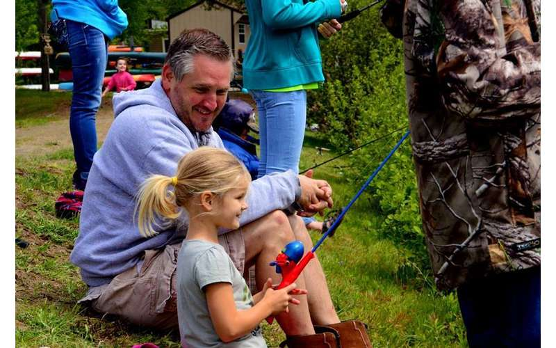 kid fishing with parent