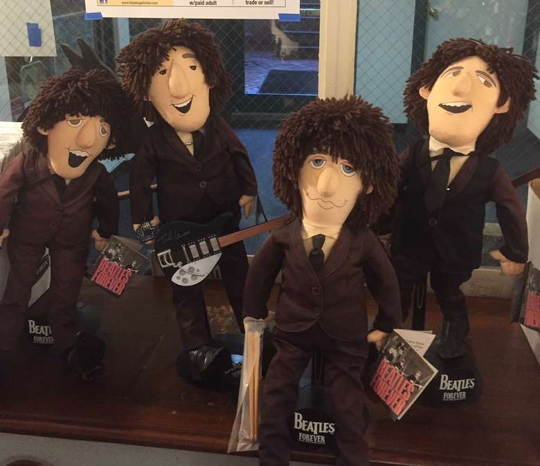 set of dolls that look like the beatles