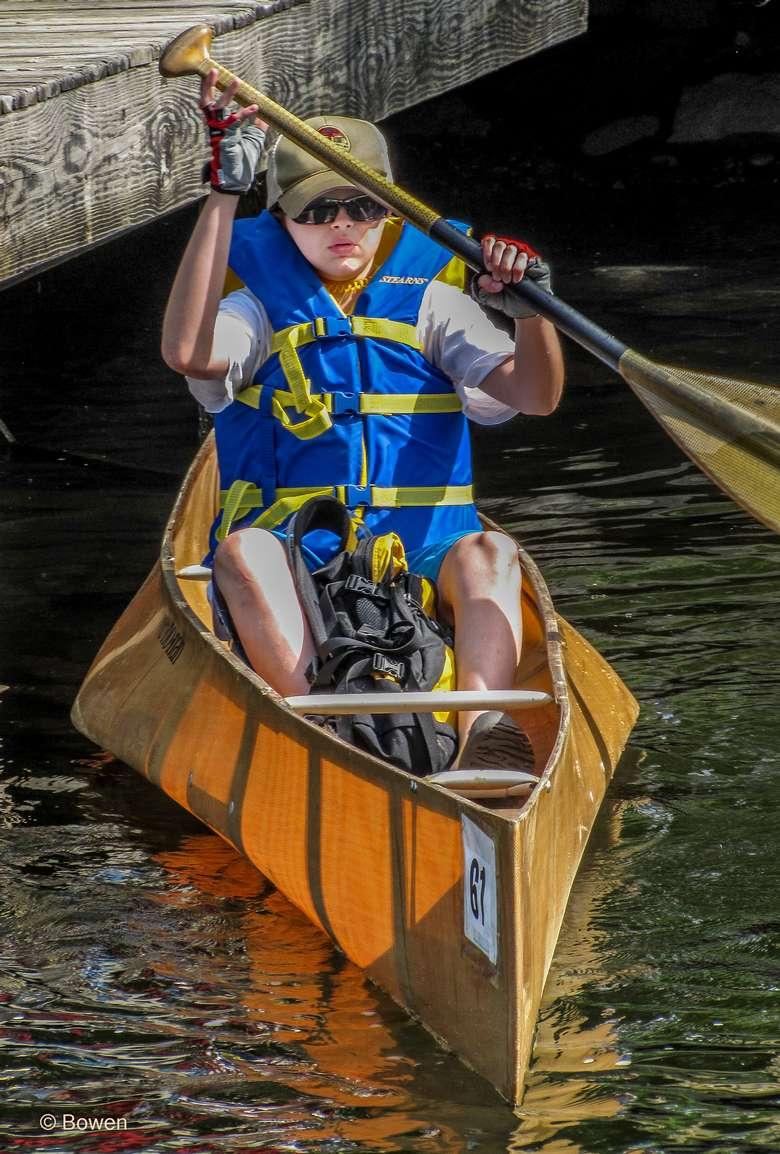 man paddles