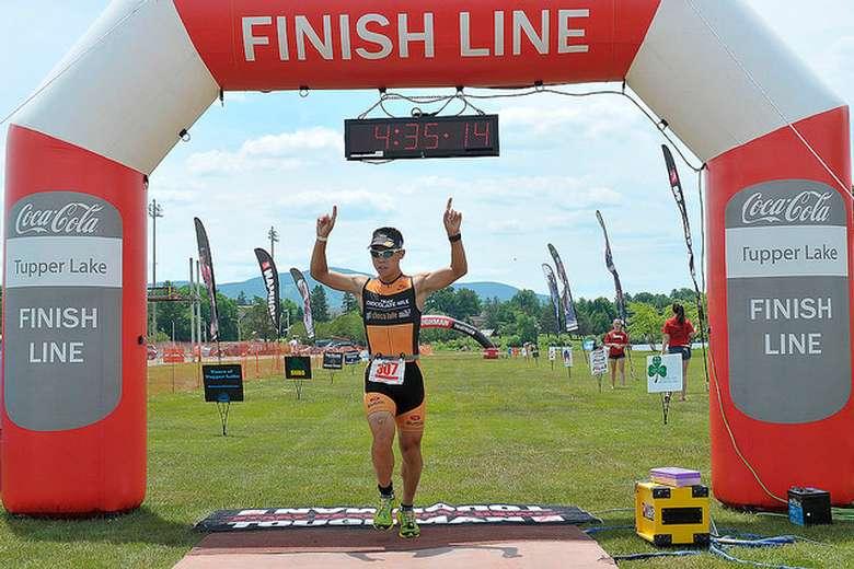 running heading across finish line
