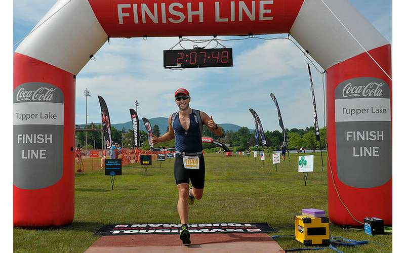 male racer crossing the finish line