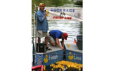 two announcers preparing people for the rubber duck race