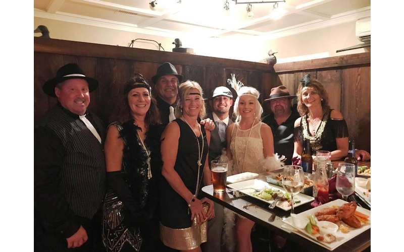 group of people dressed up in a room