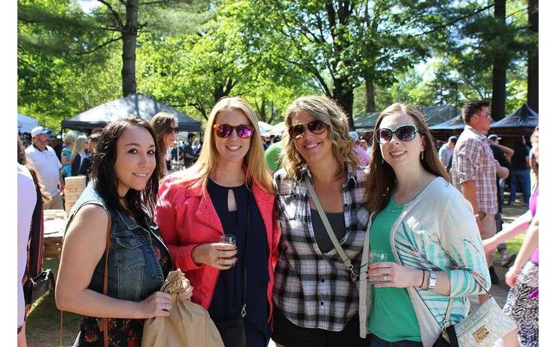 four women at beer festival