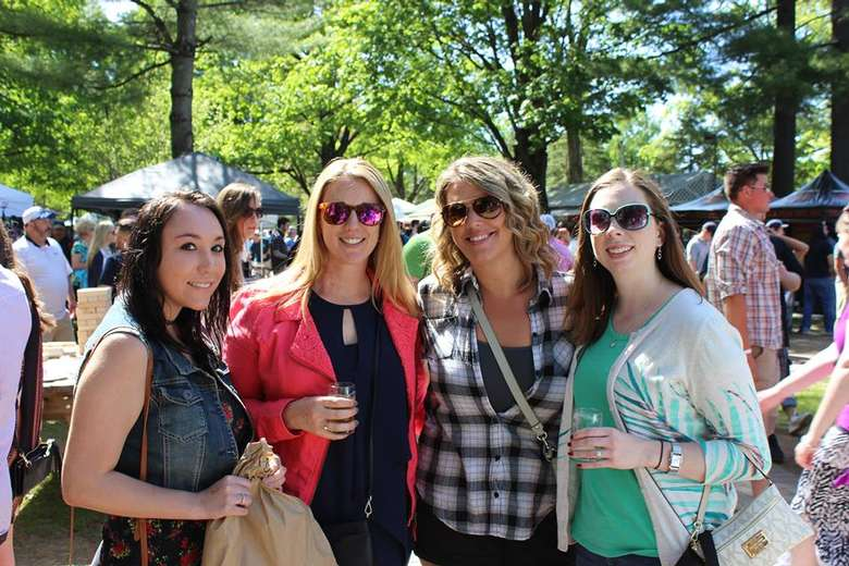 four women at beer festival