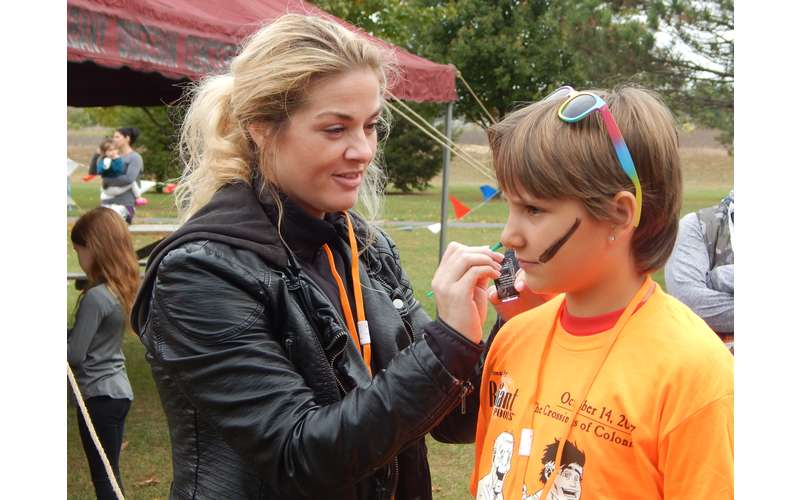 person getting their face painted