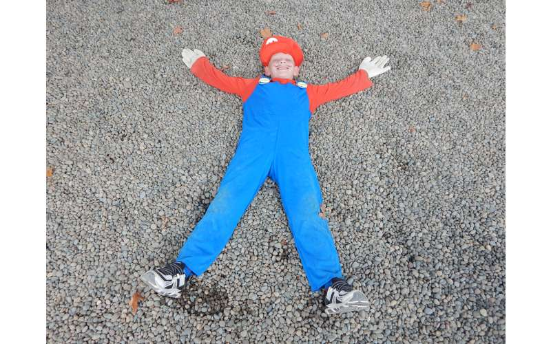 person in costume laying on ground