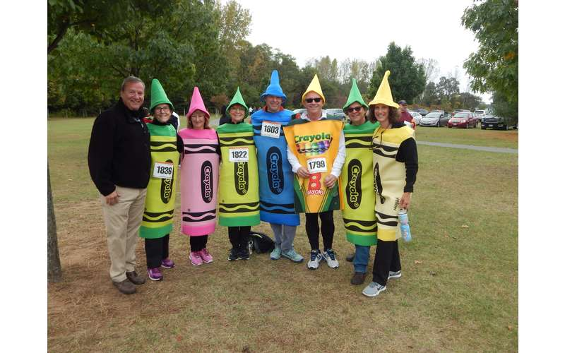 group of people dressed up as crayons