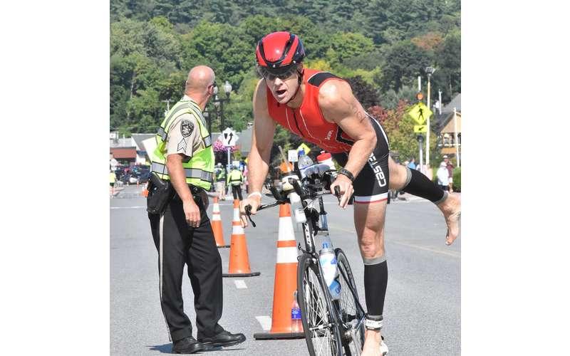 guy climbing on bike