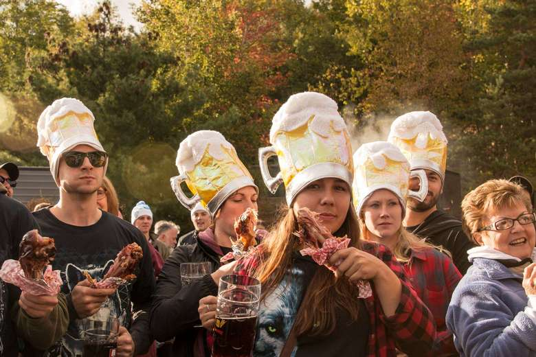 people in beer hats with chicken