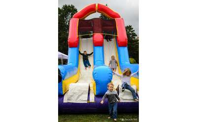 kids in bounce house slide